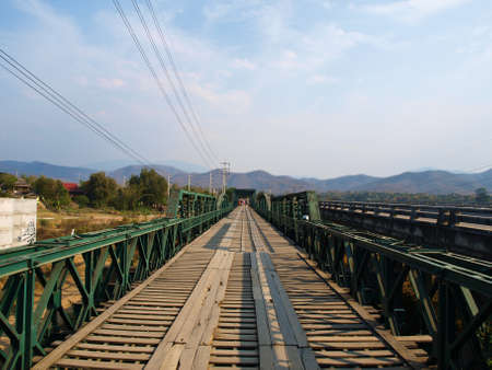 Historical bridge over the pai river in Mae hong son, Thailand photo