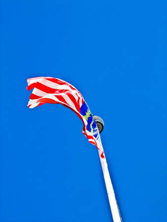 flew: Malaysia flag flew over the blue sky