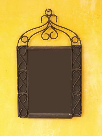 Blank menu board on yellow wall, put any text here Stock Photo