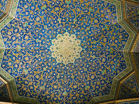 Dome of the mosque, oriental ornaments from Sheikh Loft Allah Mosque in Isfahan, Iran photo
