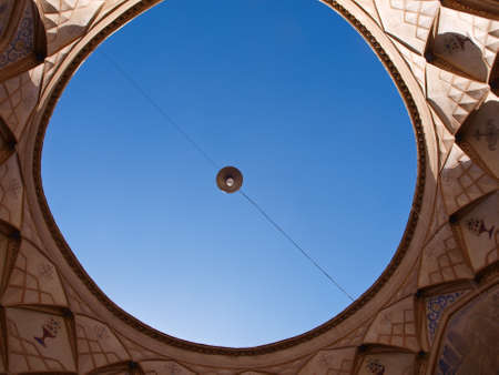 Ventilation hold and blue sky  in  kitchen in historic old house in Kashan, Iran photo