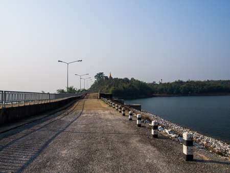 Cement road on lake in Mae Suay reservoir in Chiang rai, Thailand photo