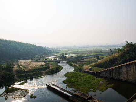 Canel and paddy field nearby Mae Suay reservoir, Chiang rai, Thailand photo