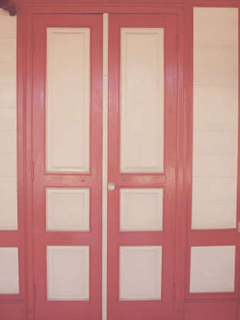cream and red wooden door in vintage style Stock Photo