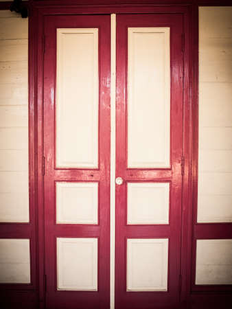 cream and red wooden door in retro style Stock Photo