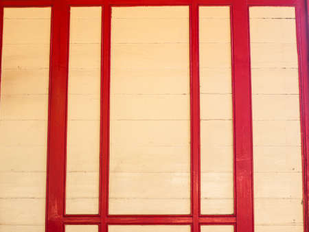 cream and red wooden panel