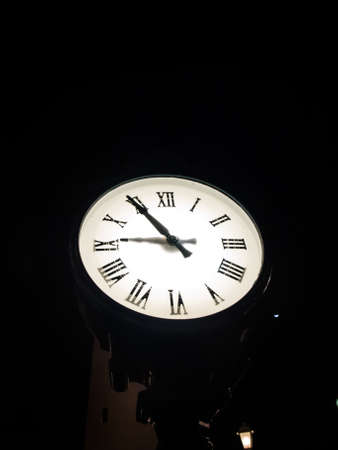 pm: outdoor clock standing at night at 9 pm Stock Photo