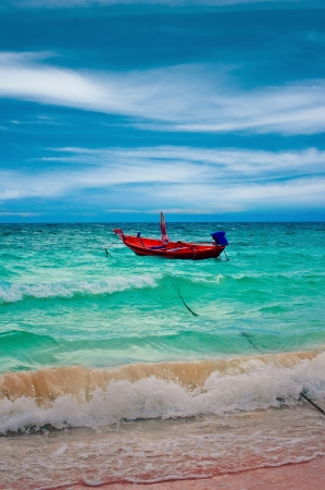 Small fishing boat on the waves during a storm, Thailand, Koh Tao photo