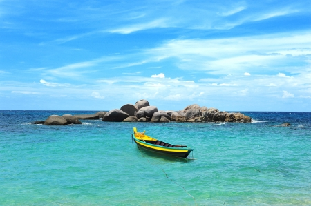 Yellow boat in the turquoise tropical sea, Koh Tao, Thailand photo