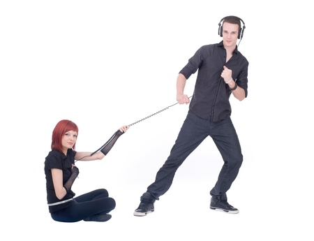 Two young people are playing with wire from the headphones photo