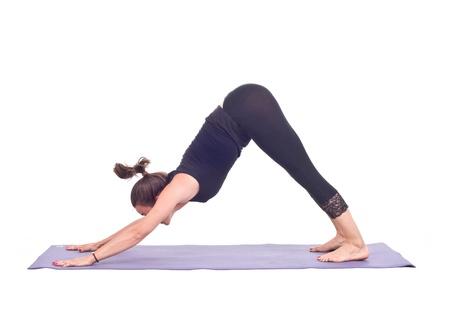 Practicing Yoga exercises   Down Dog Pose - Adho Mukha Svanasana