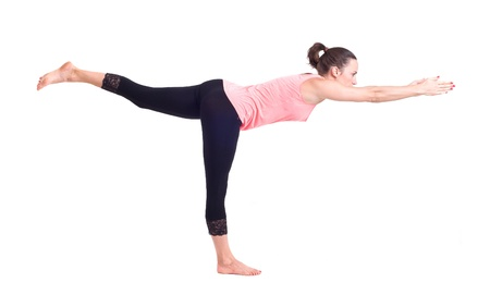virabhadrasana: Girl doing  Yoga exercises in studio on white background   Pose name  Warrior Pose - Virabhadrasana