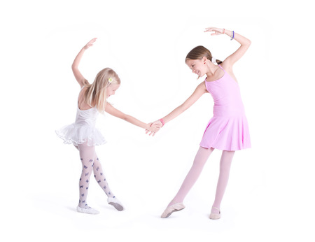 Two cute Ballerinas holding hands  photo