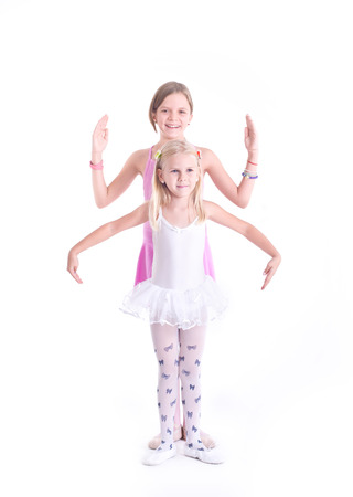Two cute Ballerinas  Isolated on a white background  Studio shot photo