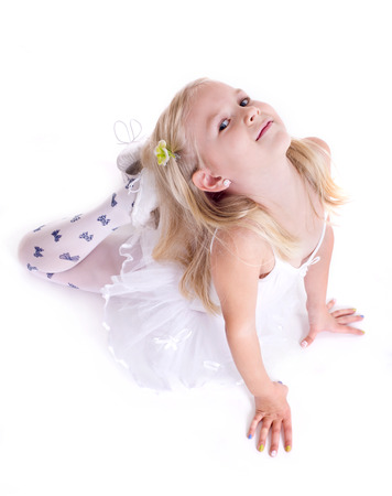 Sweet little ballerina  Isolated on a white  photo