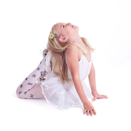 Sweet little ballerina  Isolated on a white background  Studio shot photo
