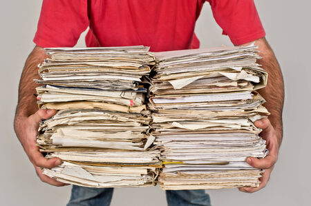 bundle of letters: Man with a bunch of old newspapers in the hands Stock Photo