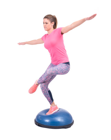 Sport woman exercise with a pilates ball  Isolated on a white background  Studio shot