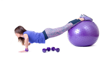 Sport woman exercise with a pilates ball and dumbbells  Isolated on a white background  Studio shot