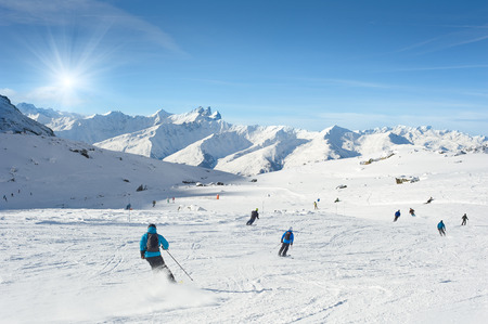 val: Skiers enjoy in the mountain on a sunny day, Val Thorens, France Stock Photo