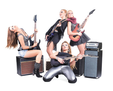 Sexy girls band  Isolated on a white background  Studio shot photo
