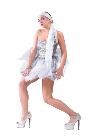 Beautiful sexy woman dancing in silver flying dress photo