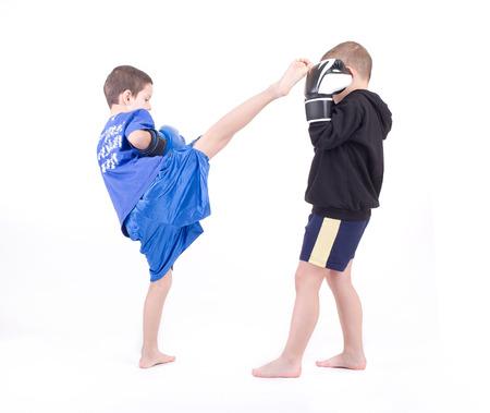 Kickboxing fighters  Isolated on a white background  Studio shot Reklamní fotografie