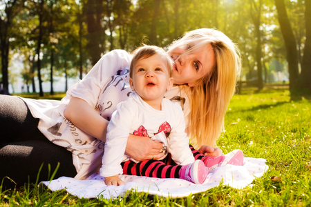 Mom and baby in nature on spring sunny day photo