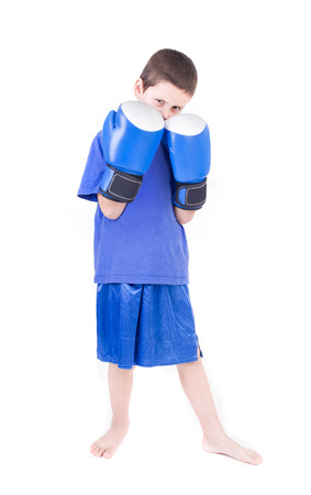 Kick boxing kid  Isolated on a white background  Studio shot Stock Photo - 27977428