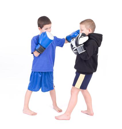 Kids Kickboxing Fight  Isolated on a white background  Studio shot