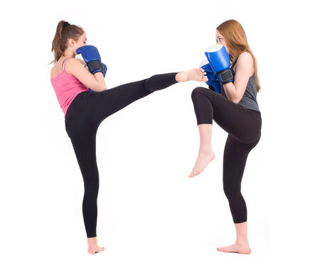 kickboxing girls fight  Isolated on a white background  Studio shot