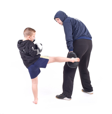 kickboxing: kickboxing kids with instructor  Isolated on a white background  Studio shot