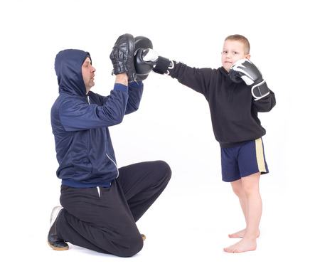 kickboxing kids with instructor  Isolated on a white background  Studio shot