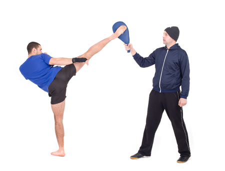 Martial Arts Sparring  Isolated on a white background  Studio shot Stock Photo