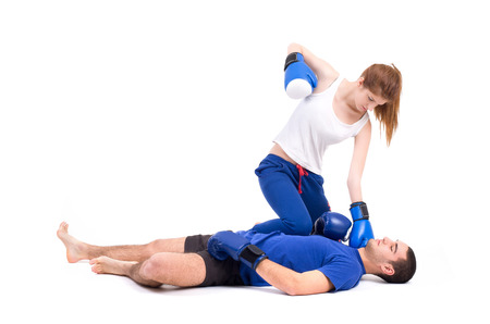 Boxing knockout  Girl knocked out man  Isolated on a white background  Studio shot Stock Photo