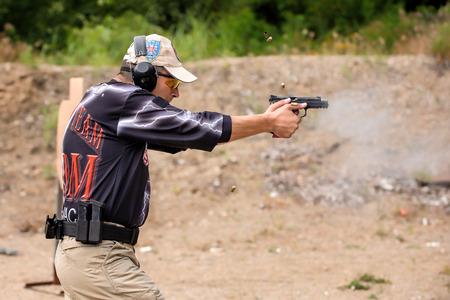 Man Shooting in Weapons Training, Outdoor Shooting Range