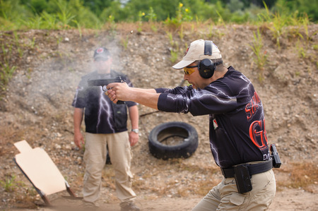 shooting target: Man Shooting in Weapons Training, Outdoor Shooting Range