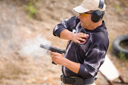 close range: Man in Pulling Gun Training, Outdoor Shooting Range