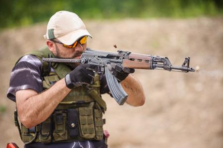 Man with Submachine Gun Shooting in Weapons Training, Outdoor Shooting Range