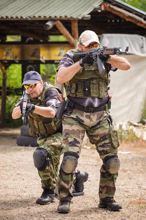 Men in Tactical Training, Shooting in Weapons Outdoor Shooting Range