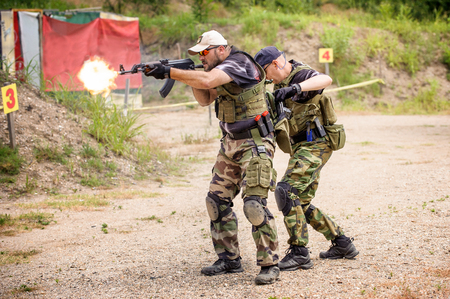 tactical: Men in Tactical Training, Shooting in Weapons  Outdoor Shooting Range