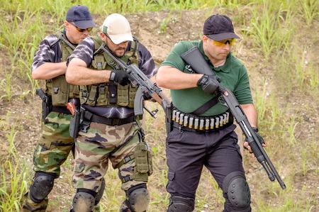 Men in Tactical Training, Shooting in Weapons Outdoor Shooting Range photo