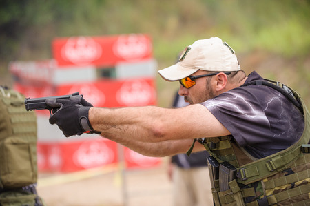 Man Shooting in Weapons Training Outdoor Shooting Range Stock Photo