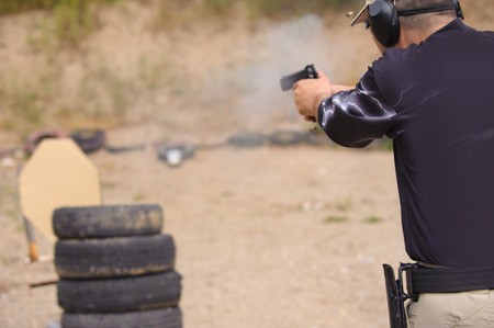 Man Shooting in Weapons Training, Outdoor Shooting Range photo