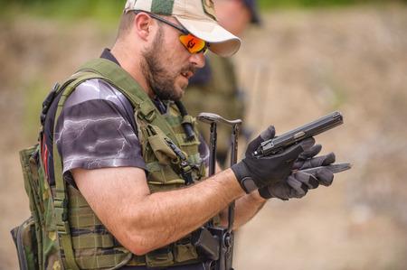 Man in Weapons Training, Outdoor Shooting Range