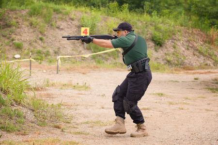 Man in Shotgun Shooting Training, Outdoor Shooting Range photo