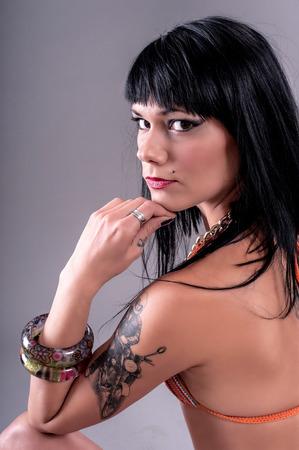 elegancy: Sensual Tattoo Girl.  Beautiful and attractive girl with tattoo. Studio shoot.