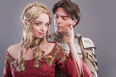 Medieval lovers. Fairy couple in medieval costumes photo