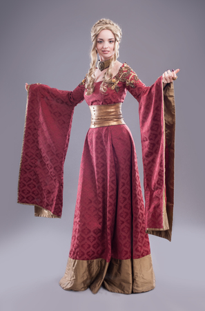 Renaissance fashion beauty. Classical beauty in a fancy renaissance dress and a matching hairdo.