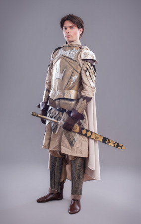 Medieval knight in armor with a sword photo